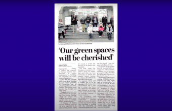 A newspaper article titled 'Our Green Spaces Will be Cherished'