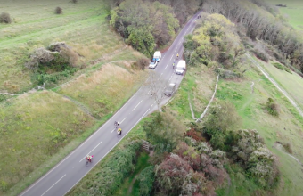 A drone photograph of cyclists riding from brighton to glasgow to visit the COP26 conference